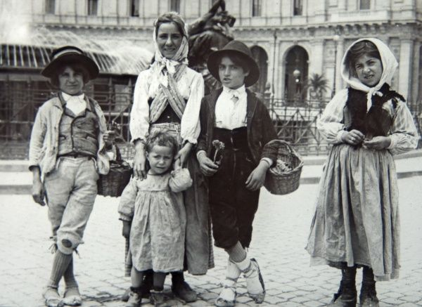 Five Romany children in traditional dress, selling flowers on the streets of Dublin, Ireland