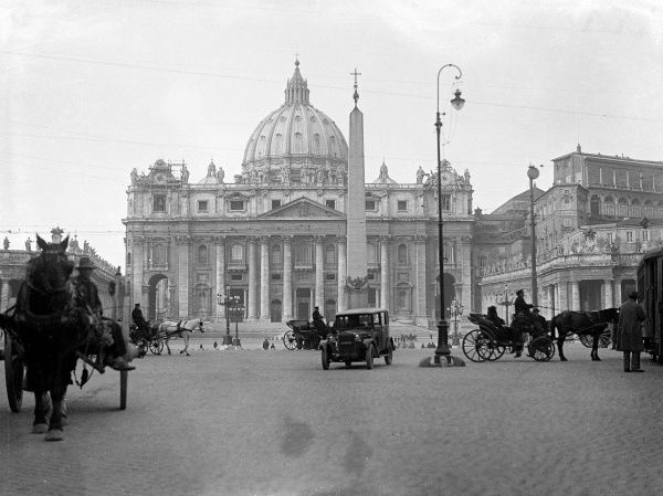 The Dome of St. Peter's and the Vatican, Rome, Italy, with the ancient Egyptian obelisk which Emperor Caligula had brought from Heliopolis in 37 A.D. Date: 1930s