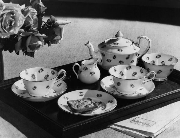 What could be nicer than waking up to a breakfast tray of dainty china - a 'Rose' tea set - teapot, cups, saucers, milk jug and sugar bowl? Date: 1930s