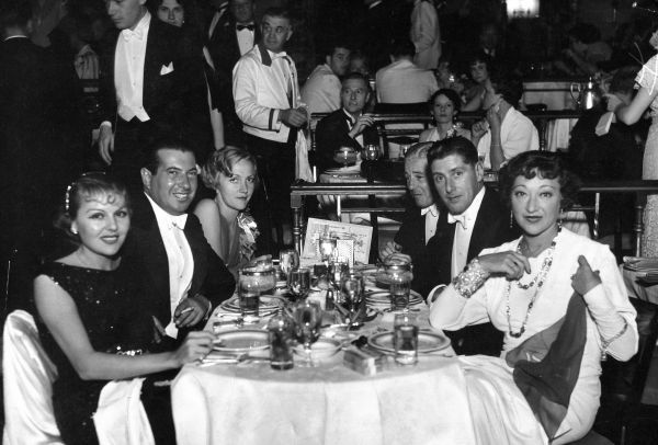 Left to right Rene Torres, Irving Netcher, Mrs Skeets Gallagher, Eddie Sutherland, unknown male and Rosie Dolly at Marion Davies benefit soiree, New York, June 1934