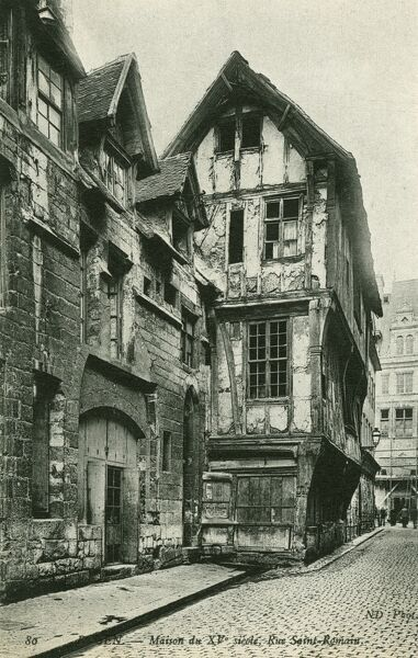 Old Medieval houses and an old fountain on the Rue St Romain, Rouen, France