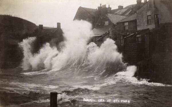 A fabulous wave hits the quayside at Staithes, Yorkshire Date: 1908