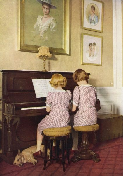 The Princesses, Elizabeth (later Queen Elizabeth II) and Margaret, playing the piano at Windsor Castle in 1940. Date: 1940