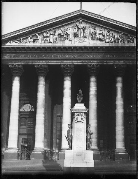 An exterior scene at the Royal Exchange with the war memorial in front of it