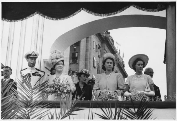 ROYAL TOUR OF SOUTH AFRICA & RHODESIA: The Royal Family (King George VI, Queen Elizabeth, Princess Elizabeth and Princess Margaret) on the dais, Station Square, Pretoria