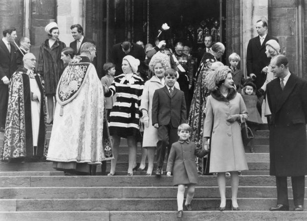 Members of the Royal family leave St. George's Chapel, Windsor after attending the Christmas service there. In the foreground is Queen Elizabeth II holding the hand of her youngest son, Prince Edward (Earl of Wessex) as she talks to her husband
