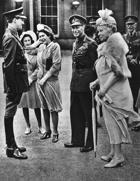 Princess Elizabeth holds onto her hat and the rest of the royal family seem to be sharing a joke during a formal presentation of thirty-six horses by Queen Wilhelmina of Holland. From left, Princess Margaret, Princess Elizabeth (Queen Elizabeth II)