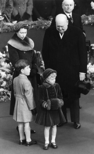 Queen Elizabeth II together with Princess Anne and Prince Charles wait at Waterloo Station with Prime Minister Sir Winston Churchill, for the return of Queen Elizabeth, the Queen Mother who was returning to the UK after her tour of the United States