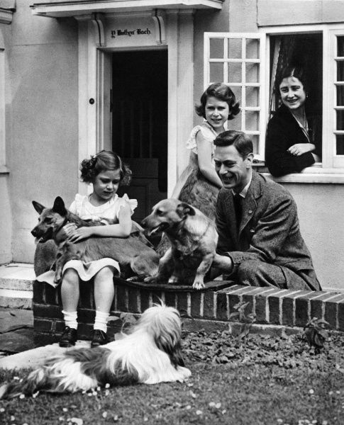 The Duke and Duchess of York, later King George VI, with their children Princess Elizabeth and Princess Margaret, and some of their dogs