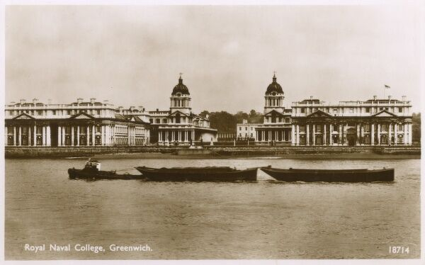 River Thames barges passing in front of the Royal Naval College, Greenwich, London