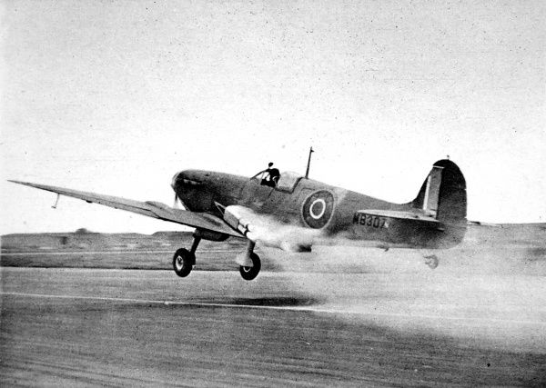 Photograph showing a rocket-assisted take-off by a Royal Navy 'Seafire' fighter during the Second World War. Rockets were used to help aircraft take off when they were either heavily laden or operating from aircraft-carrier decks
