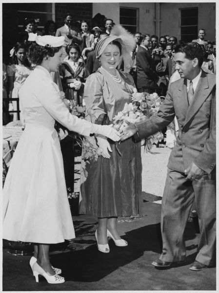 ROYAL TOUR OF SOUTH AFRICA AND RHODESIA: The Queen Mother and Princess Margaret, receiving the Honorary Treasurer of the Asian and Black Hospital, Salisbury. Date: 13 July 1953