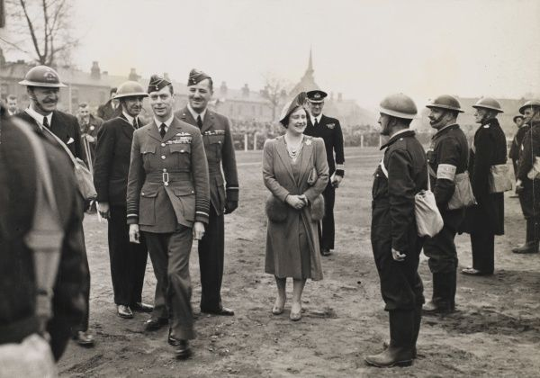 King George VI and Queen Elizabeth visit an ammunition factory in Birmingham doing their bit for the war effort during World War II