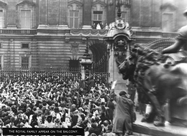 Crowds waiting outside Buckingham Palace on 20 November 1947 are rewarded by an appearance by the newlyweds and other members of the royal family on the balcony