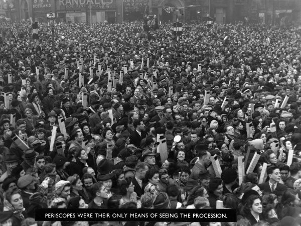 A vast crowd use periscopes as their only means of seeing the procession during the royal wedding of 1947 between Princess Elizabeth (Queen Elizabeth II) and Prince Philip, Duke of Edinburgh at Westminster Abbey on 20 November