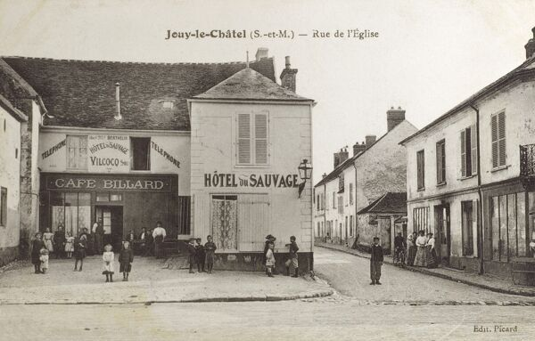 "Rue d l'Eglise - Jouy-le-Chatel, France. The message on the reverse of this card is rather fun: ""Punctured! Hence lunching at gorgeous hotel depicted! Love, J"" Date: 1914"