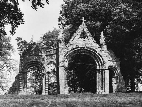 Fine Norman arches on a hilltop in Shobdon Park, Leominster, Hertfordshire, ruins of a church built in the 11th century, but demolished in the 18th century
