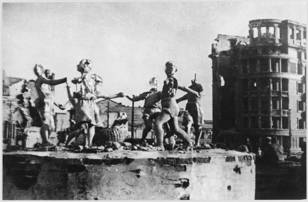 The ruins of the city, after its liberation. A sculpture of dancing children survives, though battered, like Stalingrad itself