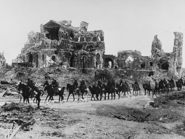 Cavalry of the Irish Division passing the ruins of the Basilica of Notre Dame de Brebieres in Albert on the Western Front in France during World War I in September 1918