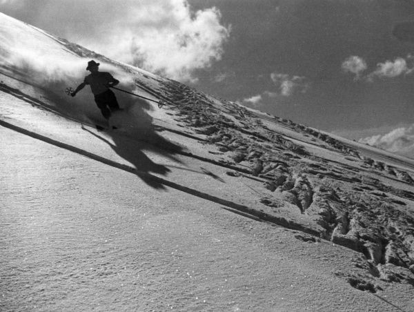 A runaway skier slices through the snow on a very steep incline! Date: 1930s