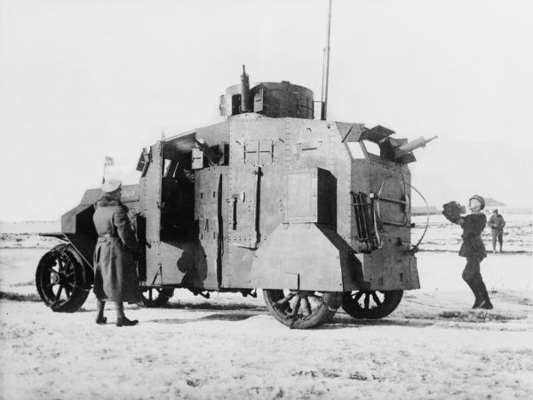 German officers examine a captured Russian armoured car