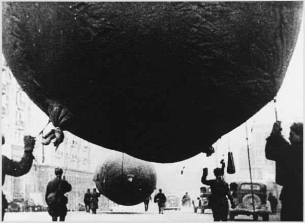 Raising barrage balloons, to protect Moscow from visiting Germans