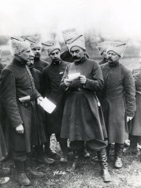 A group of Russian Cossack officers examining a document during the First World War. Date: 1914-1918