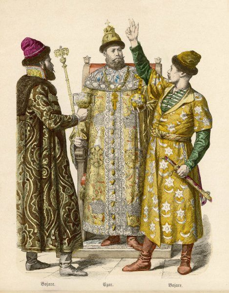 A Russian Czar on his throne with crown, sceptre & orb and two Boyars in brightly patterned ornate robes, boots & fur hats