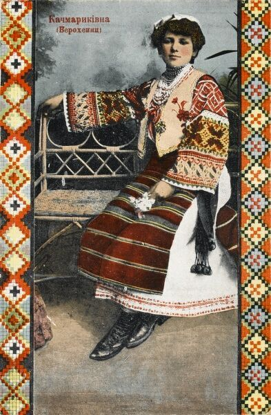 Seated Russian Lady in traditional costume - the card is bordered on either side by terrific russian-style diamond and chevron patternation