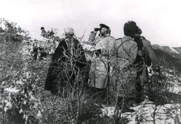 A Russian commander and Cossack scout officers near the wall of Krakow on the Eastern Front during the First World War, making observations on the enemy's positions. Date: circa 1914