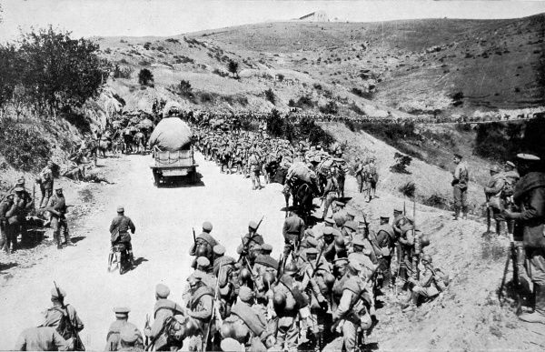 Russian soldiers, recently arrived in the Allied encampment at the Greek port of Salonika, are shown marching towards the Balkan front