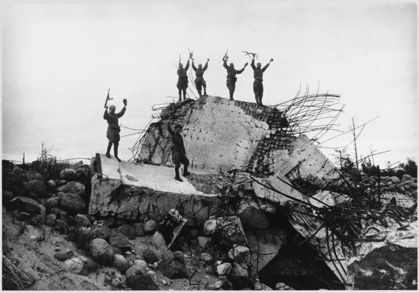 Triumphant Russian soldiers on a ruined bunker on the outskirts of Berlin
