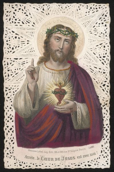 Jesus holds his sacred heart in one hand, raises a pointing finger with the other, warning you not to misbehave