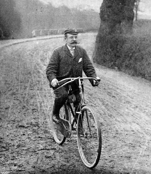 Photograph of a cyclist and his 'Safety' bicycle of the 1890's. John Kemp Starley produced the first 'safety' bicycle with his 'Rover' design of 1885