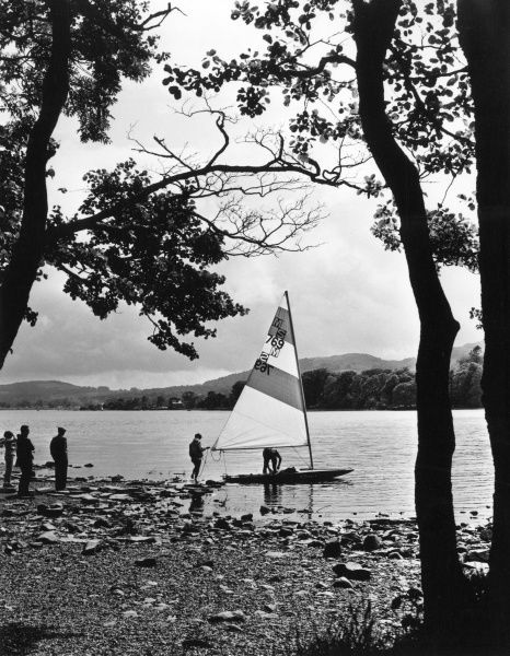 A sailing scene, by the shores of Lake Coniston, Lake District, Cumbria, England. Date: 1960s