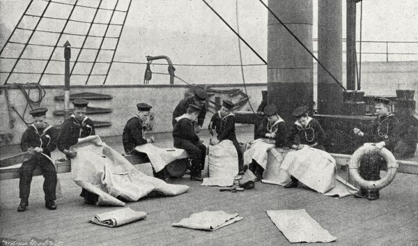 Boys taking part in a sailmaking class on the Training Ship Wellesley, on the River Tyne at North Shields, Northumberland