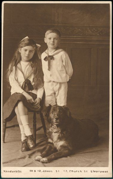 Two sailor-suited children from Liverpool, posing with their apprehensive dog