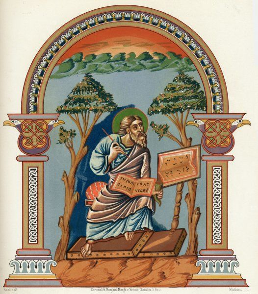SAINT JOHN THE EVANGELIST depicted writing the first words of his gospel, 'In the beginning was the word...&#39
