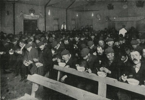 A midnight supper of soup and bread at a London Salvation Army shelter for men brought in from the streets