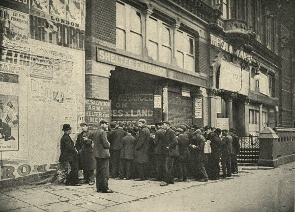 A crowd of vagrants awaiting admission to the Salvation Army shelter for men (known as The Embankment) at 115B Blackfriars Road, London