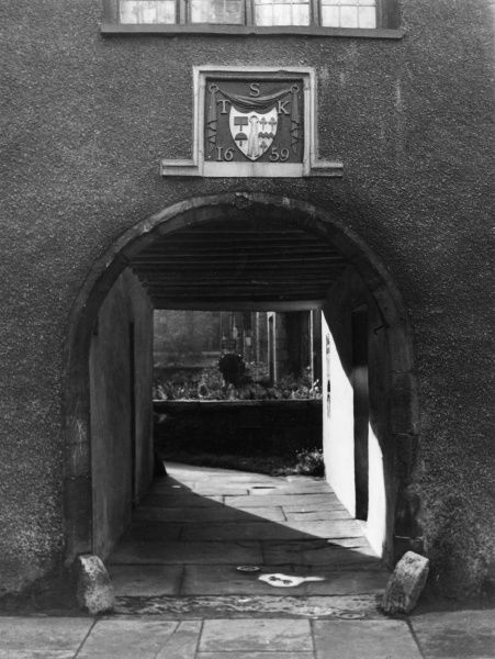 An old archway at Highgate, Westmorland, England, which leads to Sandes Hospital. These almshouses were erected in 1659 by Thomas Sandes. Date: 17th century
