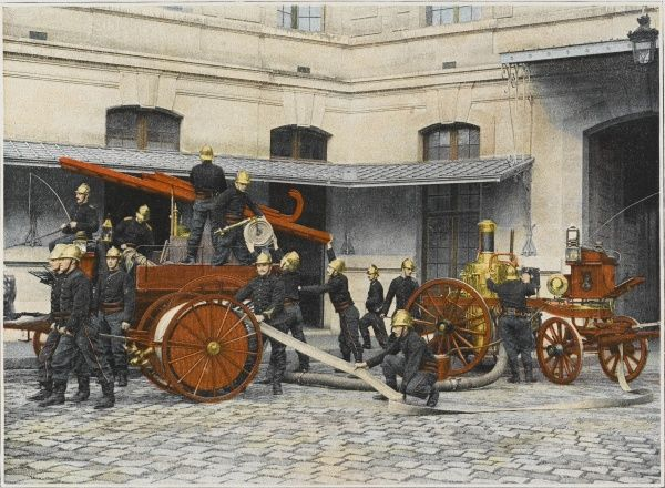 French sapeurs-pompiers manoeuvre their engines at the scene of a fire