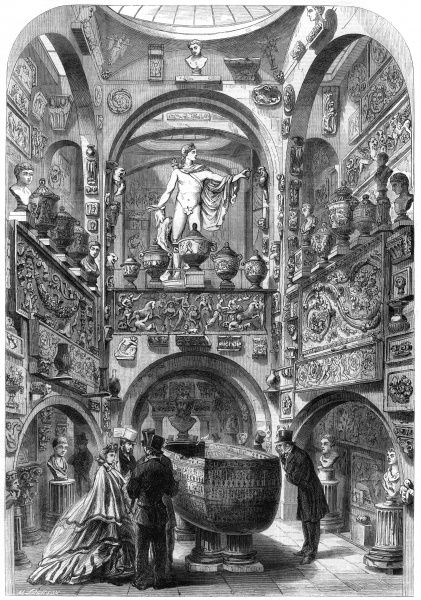 Engraving showing the interior of the Sarcophagus Room of Sir John Soane's Museum in Lincoln's Inn Fields, London, 1864. Several visitors in Victorian dress are shown admiring the ancient objects and sculptures. Date: 25 June 1864