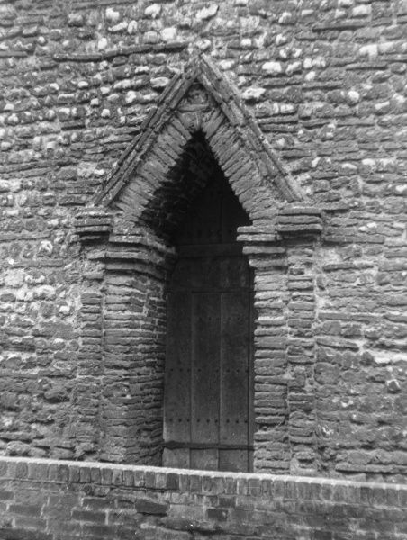 The fine pointed Saxon doorway of Holy Trinity Church, Trinity Street, Colchester, Essex, England. Date: 11th century