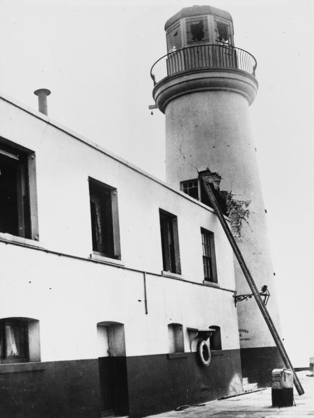 Damage to Scarborough lighthouse caused by a shell during the German air raid on Scarborough, England, during World War I in December 1914