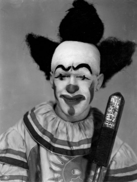 A rather scary clown, with three sinister tufts of hair and cross eyebrows. Date: 1930s