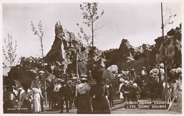 View of the Scenic Railway, with people in the foreground, at the Franco-British Exhibition, held at White City, West London. Date: 1908
