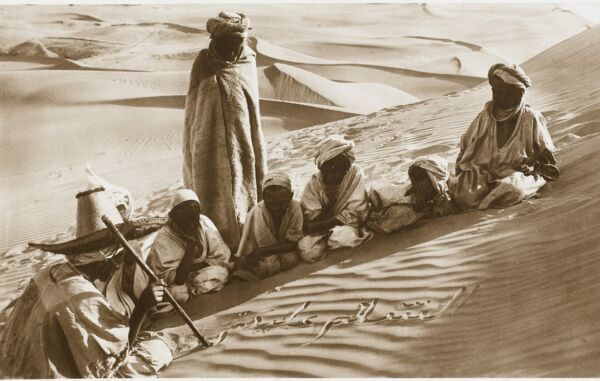 Taking a school lesson in the desert. A magnificent photograph