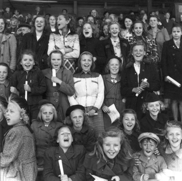 Supporters at a school match, Trelleborg, 1950. Date: 1950