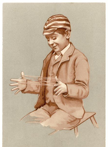 Schoolboy playing cat's cradle
